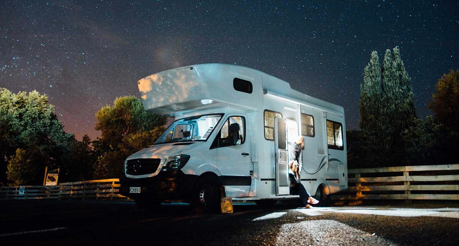 White motorhome parked at night