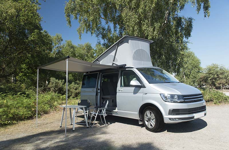 VW Campervan parked with tables and chairs