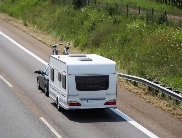 Car towing caravan on motorway